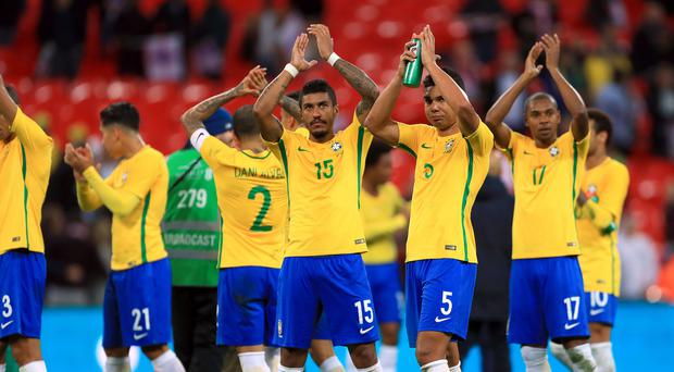 Brazil footballers applaud the fans after the final whistle
