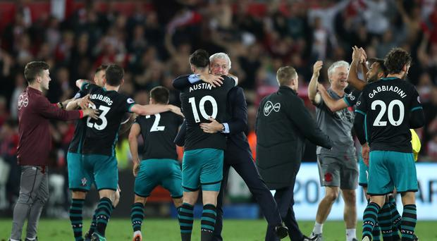 Southampton manager Mark Hughes (centre) celebrates with Charlie Austin after the final whistle (Simon Cooper/EMPICS)