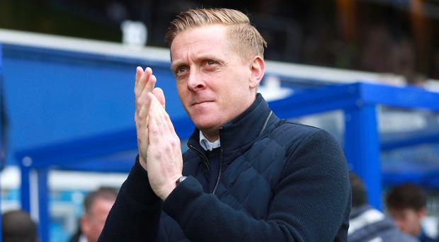 A Cardiff fan got a tattoo of former Swansea manager Garry Monk on his behind after the Welsh club's promotion to the Premier League