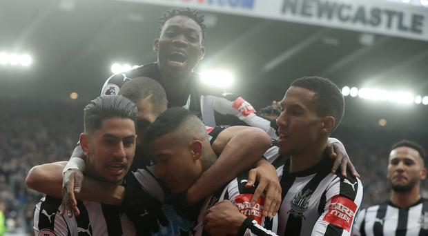 Newcastle United players celebrate a goal