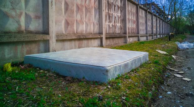 An abandoned mattress (Arturs Graudins/Getty Images)
