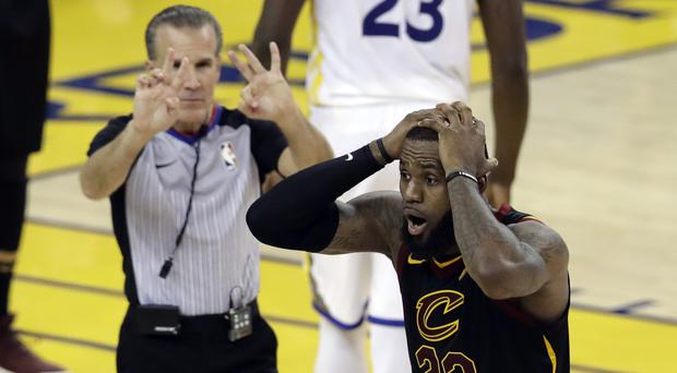 Cleveland Cavaliers basketball player LeBron James reacts to a decision during the NBA finals (Marcio Jose Sanchez/AP)