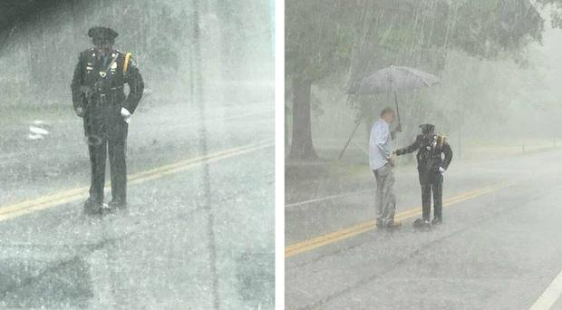 A police officer helping a snapping turtle in the rain (Carolyn BR Hammett/Honora Hammett/PA)