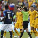 The referee during France and Australia's World Cup game gives a penalty to France (Pavel Golovkin/AP)