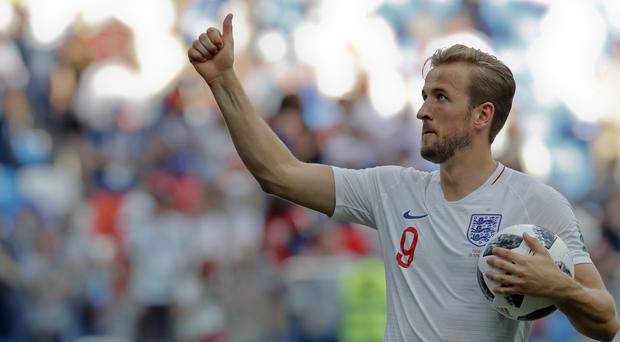 England's Harry Kane holds the match ball after scoring a hat-trick against Panama at the 2018 World Cup (Antonio Calanni/AP)