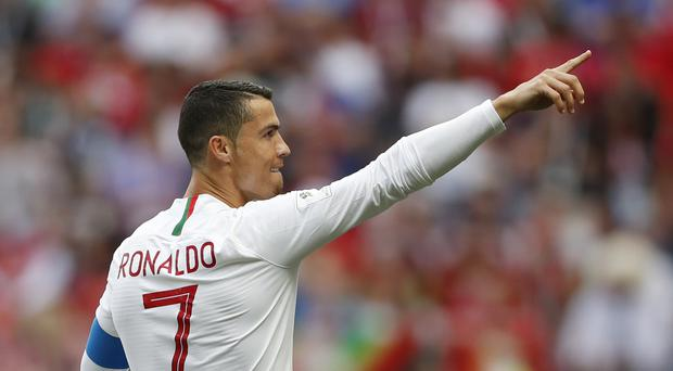 Portugal's Cristiano Ronaldo celebrates scoring a goal at the 2018 World Cup (Francisco Seco/AP)