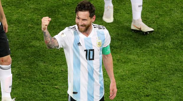 Argentina's Lionel Messi celebrates after Argentina progressed to the knock-out stage of the 2018 World Cup (Owen Humphreys/PA)