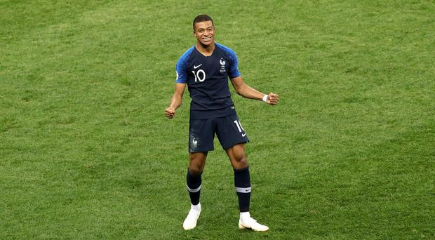 France's Kylian Mbappe celebrates scoring his side's fourth goal of the game during the FIFA World Cup Final at the Luzhniki Stadium, Moscow. (Aaron Chown/PA)