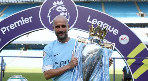 Manchester City manager Pep Guardiola and the Premier League trophy (Martin Rickett/PA)