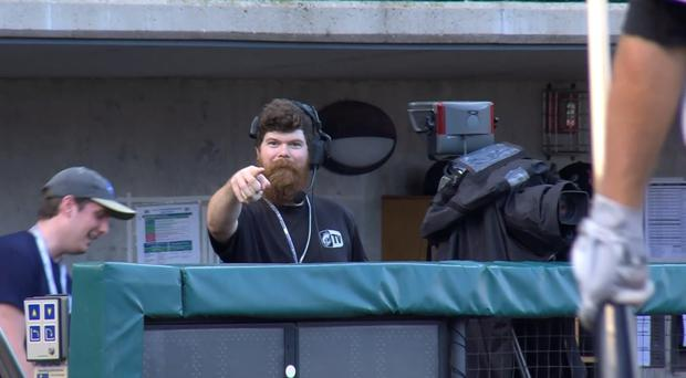 A cameraman points down the camera after taking a catch (Columbus Clippers/commoninternetuser)