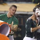 Two Oakland Athletics baseball players celebrate winning a game (Ben Margot/AP)