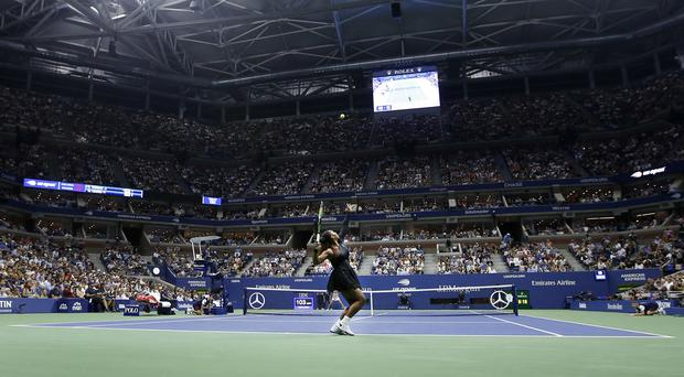 Serena Williams serves during the first round of the US Open (Jason DeCrow/AP)