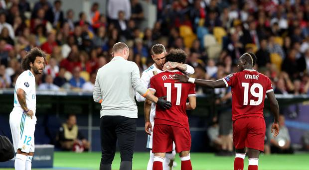 Real Madrid's Sergio Ramos consoles Liverpool's Mohamed Salah – (Nick Potts/PA)