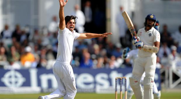 England's Alastair Cook celebrates after taking a Test wicket against India – (Nigel French/PA)