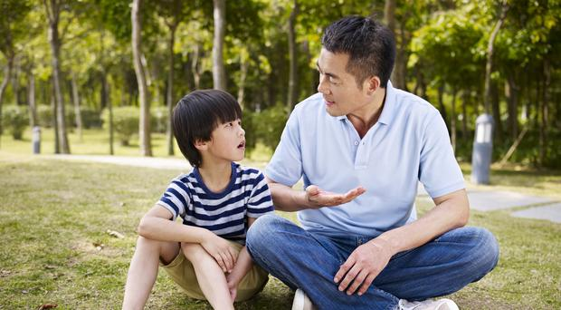 A father and son have a conversation – (imtmphoto/Getty Images)