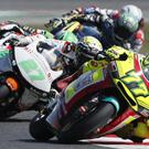 Footage shows Manzi briefly shaken off balance by the incident before regaining control of his bike (Antonio Calanni/AP)