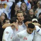 England celebrate Harry Kane's goal against Croatia during the Nations League (Rui Vieira/AP)