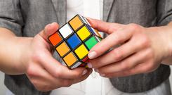 Taking it back to the 1980s, one Northern Ireland schoolboy has put on a impressive display to solve a Rubik's cube in less than a minute.