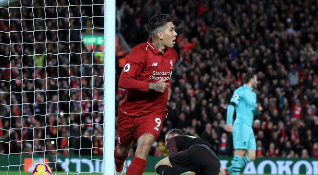 Liverpool's Roberto Firmino celebrates scoring a goal against Arsenal at Anfield – (Peter Byrne/PA)