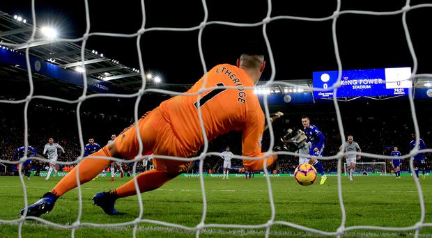 Cardiff City goalkeeper Neil Etheridge saves a penalty from Leicester City's James Maddison (Nick Potts/PA)