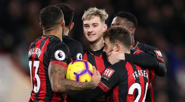 Bournemouth's Ryan Fraser (right) celebrates scoring his side's third goal of the game during the Premier League match at the Vitality Stadium, Bournemouth (Andrew Matthews/PA)