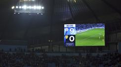 The board displays Manchester City 9-0 win at the end of the English League Cup semi-final first leg soccer match between Manchester City and Burton Albion (Dave Thompson/AP)