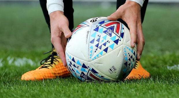 The match ball is placed for a free kick (Mark Kerton/PA)