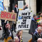 Anti-Brexit campaigners take part in the People's Vote March in London (Yui Mok/PA)