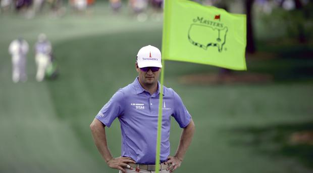 Zach Johnson looks at the green on the seventh hole during a practice round for the Masters golf tournament (Charlie Riedel/AP)
