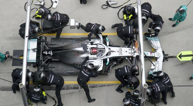 Lewis Hamilton making a pit stop at the Chinese GP (Hu Chengwei/AP)