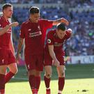 Liverpool's James Milner (right) celebrates Liverpool's second goal during the Premier League match at The Cardiff City Stadium, Cardiff. (David Davies/PA)