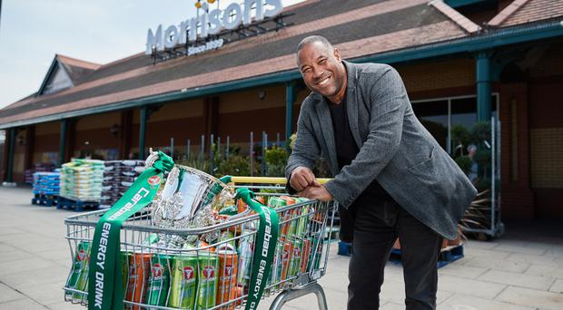 John Barnes poses with a trolley full of Carabao and the Carabao Cup (EFL/PA)