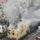 Smoke billows from the Kyoto Animation (Kyodo News via AP)