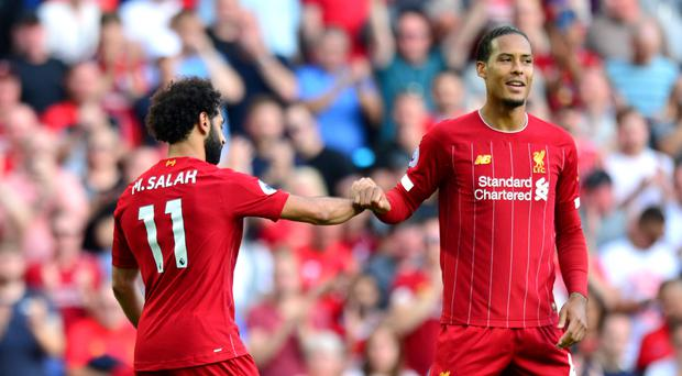 Mohamed Salah (left) celebrates scoring his side's second goal of the game with team-mate Virgil van Dijk (Anthony Devlin/PA)