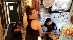 Siesta Key Oyster Bar staff pull notes from the wall (Siesta Key Oyster Bar)