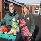 Edinburgh Dog and Cat Home staff with pet food bank supplies (ECDH/PA)