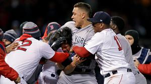 New York Yankees right fielder Aaron Judge puts Boston Red Sox relief pitcher Joe Kelly in a headlock