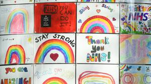 Rainbow signs painted by students in the window of the DLD College across the road from St Thomas' Hospital (Kirsty O'Connor/PA)
