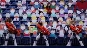 Denver Broncos cheerleaders perform as two fans sit among cardboard characters from the show South Park (Jack Dempsey/AP)