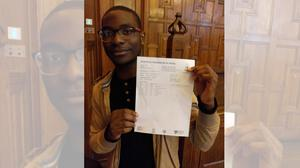 Pierre Hamenya with his 2017 A-level results (Pierre Hamenya/Twitter)