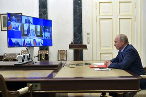 Russian President Vladimir Putin chairs a security council meeting via video conference in Moscow, Russia (Alexei Druzhinin/AP)