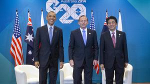 Barack Obama with Australian Prime Minister Tony Abbott and Japanese premier Shinzo Abe. (AP)