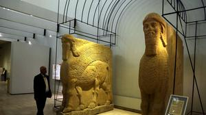 Iraqi PM Haider al-Abadi has vowed to track down and punish those who were behind the smashing of rare ancient artifacts in the northern Iraqi city of Mosul (AP)