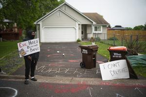 Amanuel Soquar stands outside the home of fired Minneapolis police Officer Derek Chauvin (Jeff Wheeler/Star Tribune/AP)