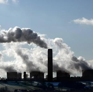 China is to reward cities for reducing pollution