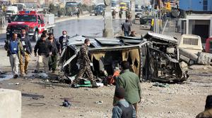 Afghan security forces inspect a British embassy vehicle which was targeted in a suicide attack in Kabul, Afghanistan (AP)