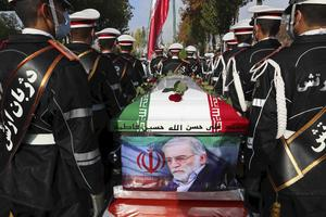 Military personnel stand near the flag-draped coffin of Mohsen Fakhrizadeh (Iranian Defence Ministry/AP)