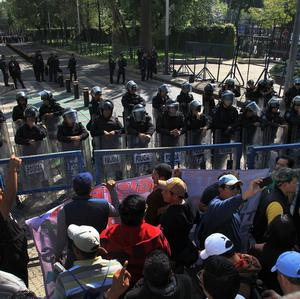 Striking teachers protest outside the US embassy in Mexico City in a demonstration against educational reforms (AP)