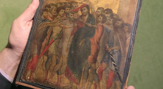 The painting has been attributed to the 13th-century Italian painter Cimabue (Michel Euler/AP)