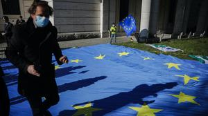 The Pulse of Europe movement collects signatures for more support for Italy in front of the Italian embassy in Berlin (AP Photo/Markus Schreiber, File)